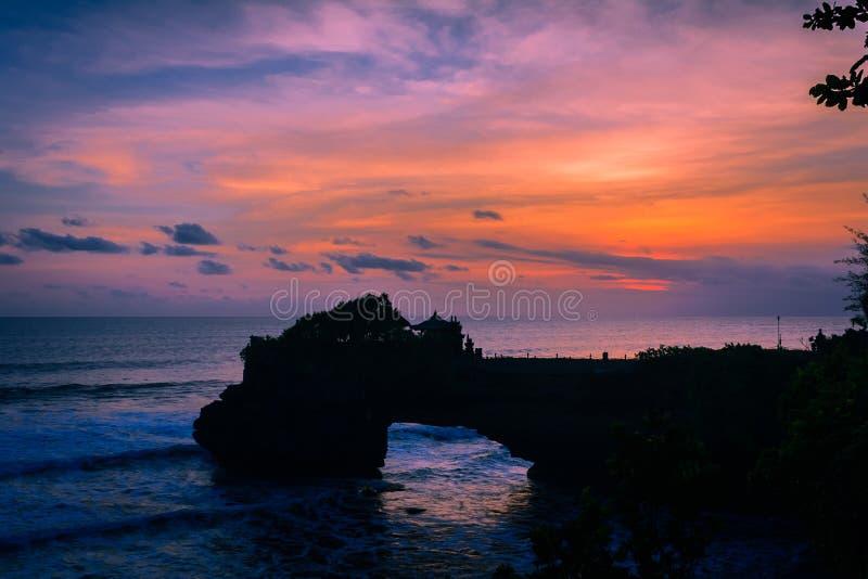 Заход солнца bolong batu Pura стоковое фото