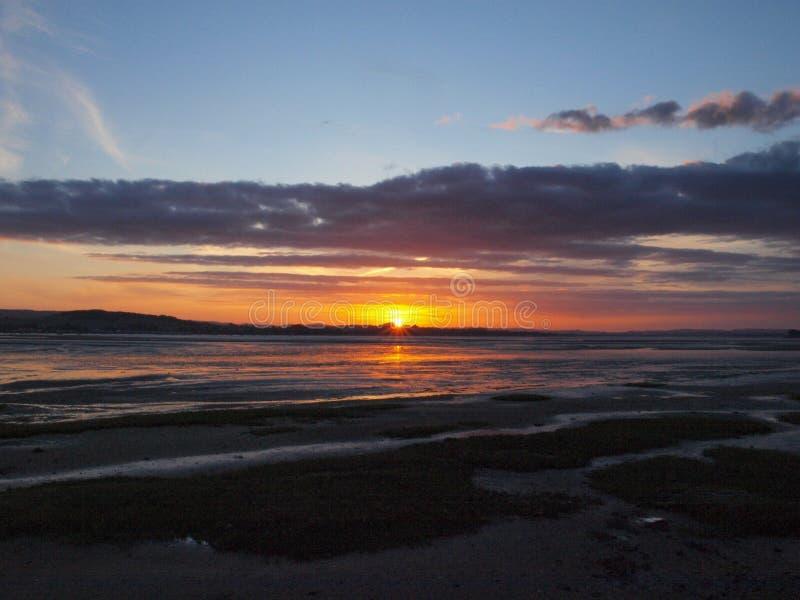 Заход солнца Exmouth пляжем в Девоне стоковое фото rf