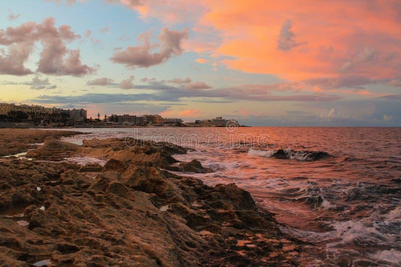 заход солнца malta стоковое фото