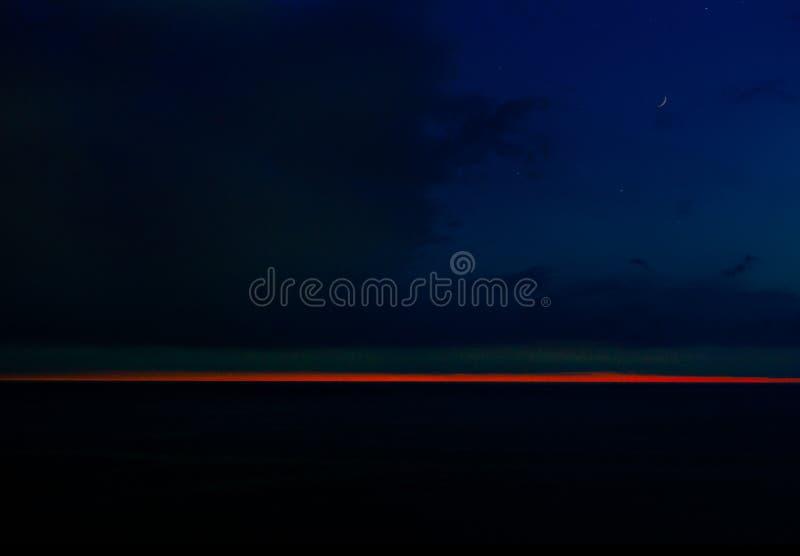 Заход солнца Suble на море стоковое фото