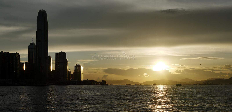 заход солнца victoria Hong Kong гавани стоковые изображения