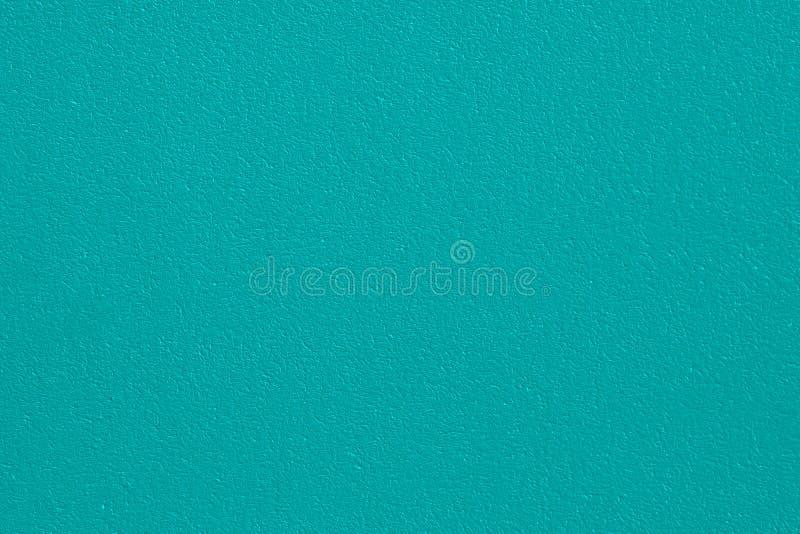 Заштукатуренная бетонная стена, покрашенная в изумрудном цвете, поверхностная текстура в высоком разрешении стоковая фотография