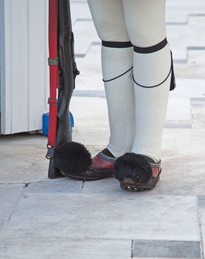 Защитите ботинки на президентском дворце, Афин, Греции стоковые изображения