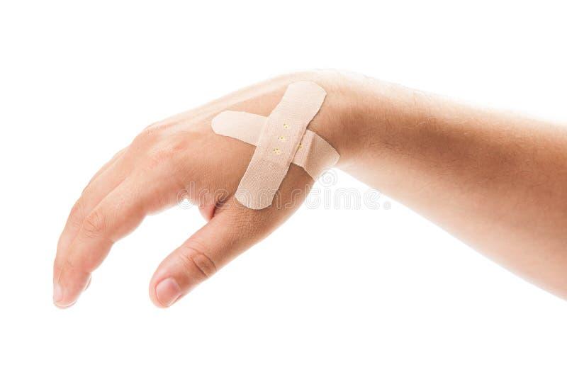 Залатанная рука на белой предпосылке стоковые изображения rf