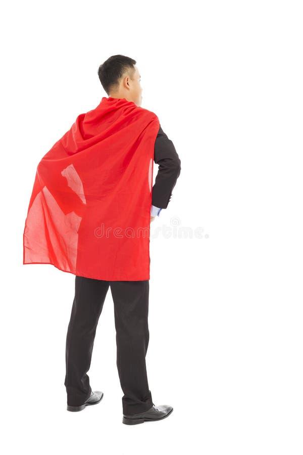 Задний бизнесмен взгляда с красным цветом shaw супергероя стоковые изображения rf
