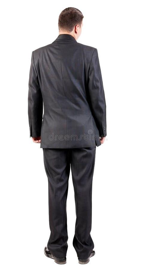 Задний взгляд бизнесмена в черный наблюдать костюма. стоковые фотографии rf