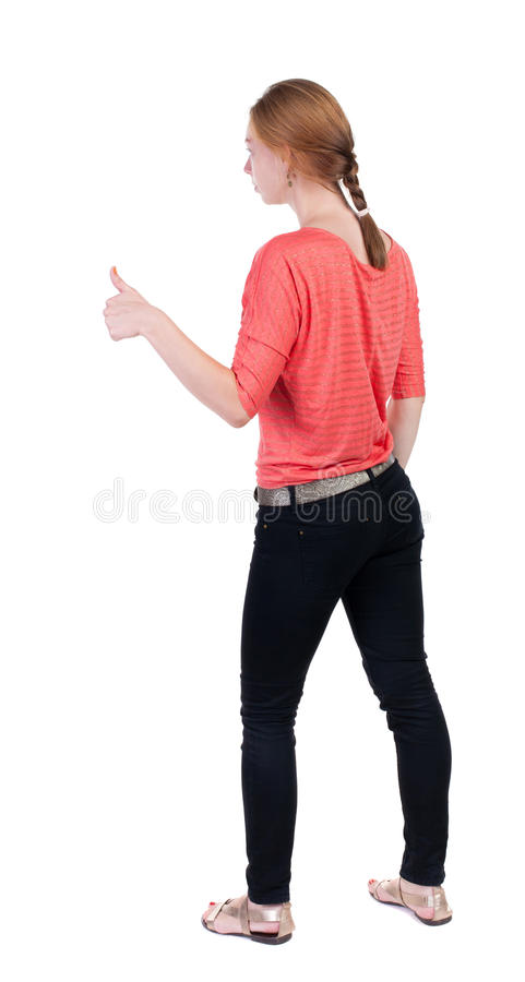 Задний взгляд больших пальцев руки женщины вверх стоковое фото rf