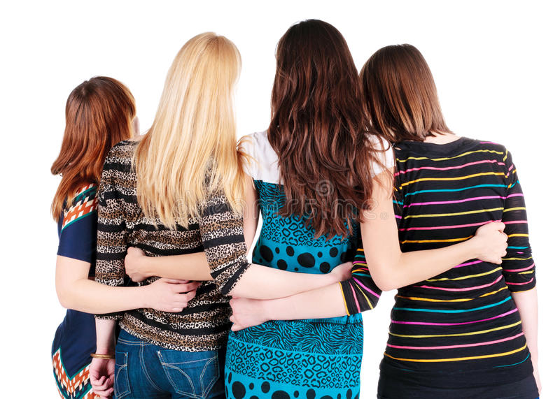 Задний взгляд группы в составе молодые женщины обсуждая и наблюдая. стоковые фото