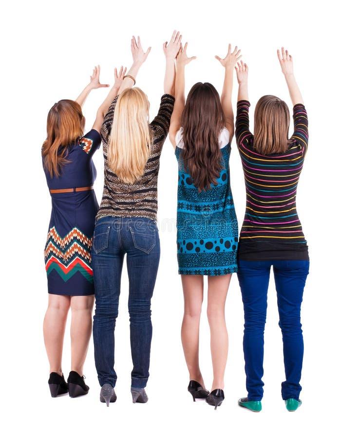 Задний взгляд группы в составе молодые женщины стоковое изображение rf