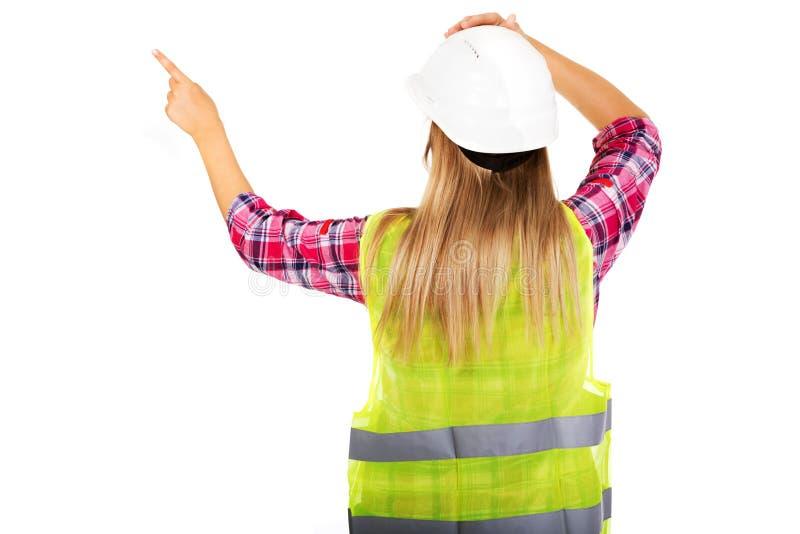 Задний взгляд женского построителя в жилете стоковое изображение