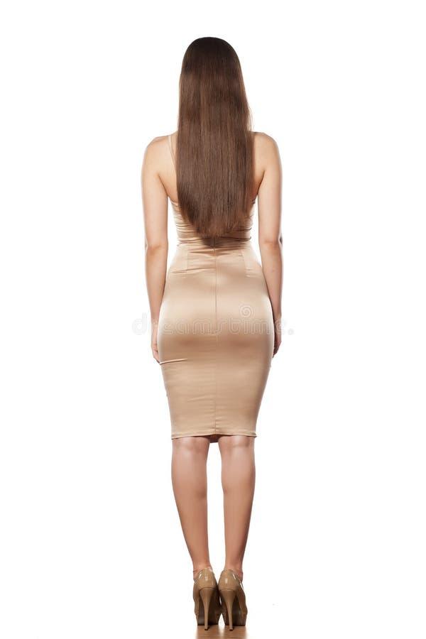 Задний взгляд женщины стоковое фото