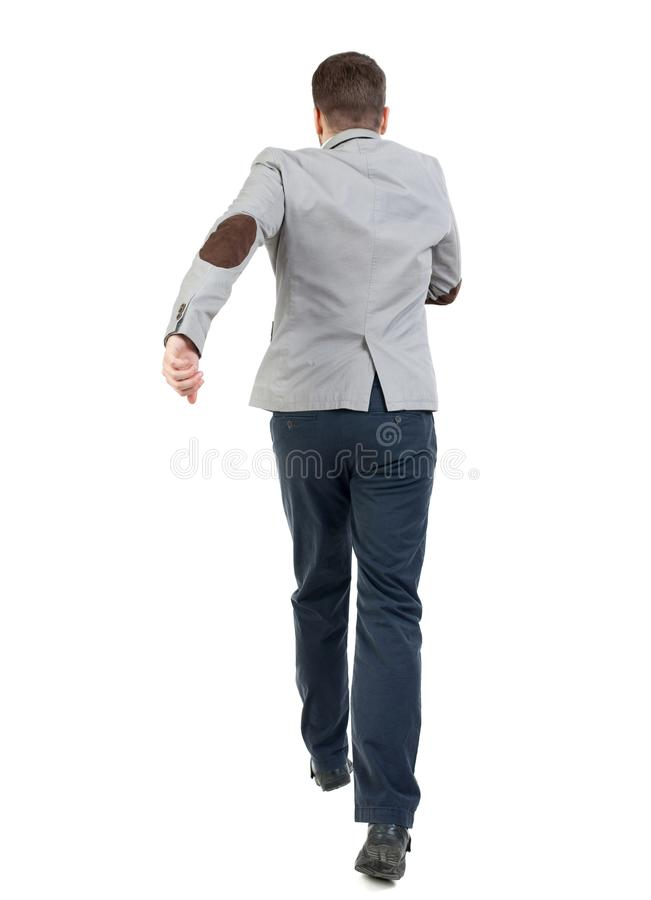 Задний взгляд идущего бизнесмена стоковое фото rf