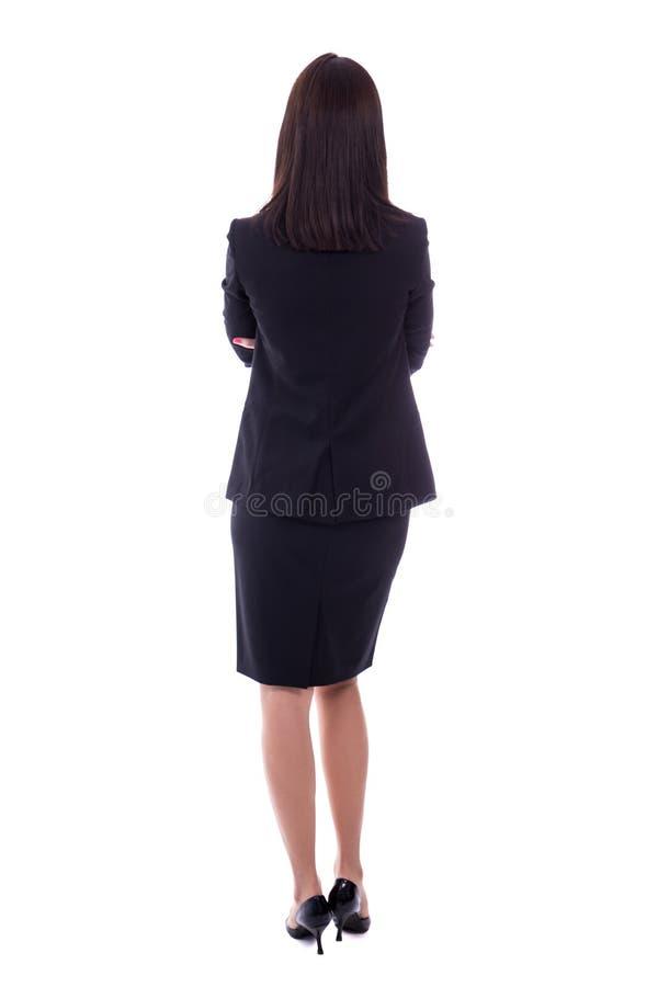 Задний взгляд молодой женщины в деловом костюме изолированном на белизне стоковые фото