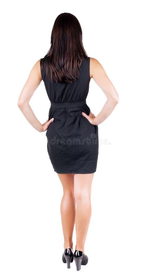Задний взгляд стоять молодая красивая женщина брюнет стоковые изображения rf