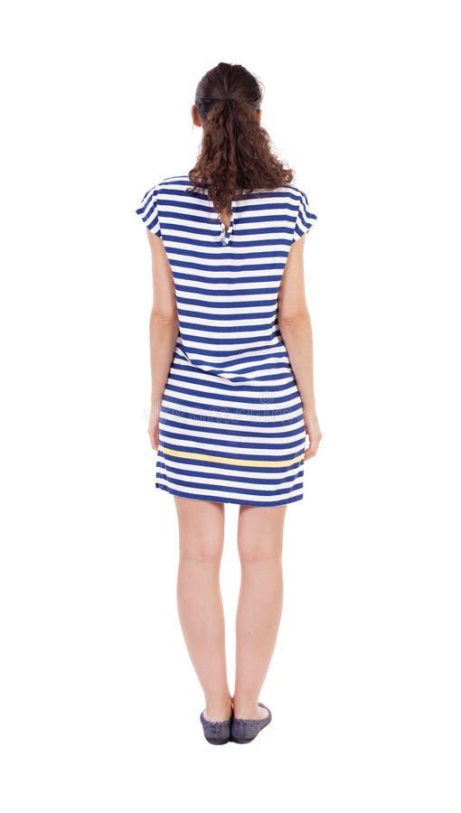 Задний взгляд стоять молодая красивейшая женщина стоковое изображение