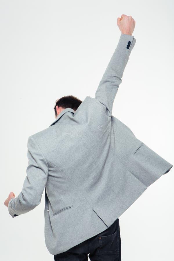 Задний портрет взгляда бизнесмена празднуя его успех стоковое изображение rf