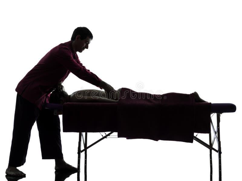 Задний силуэт терапией массажа стоковые изображения