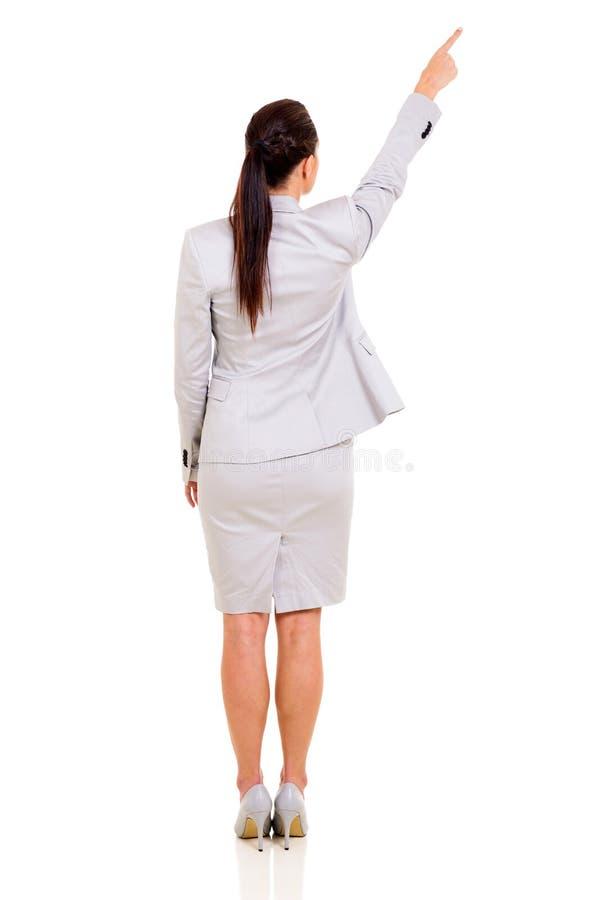 Задний указывать женщины стоковое фото rf