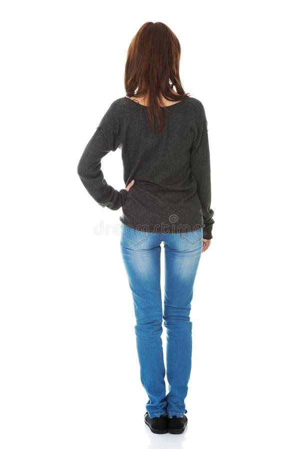 Задняя сторона женщины стоящая стоковые изображения