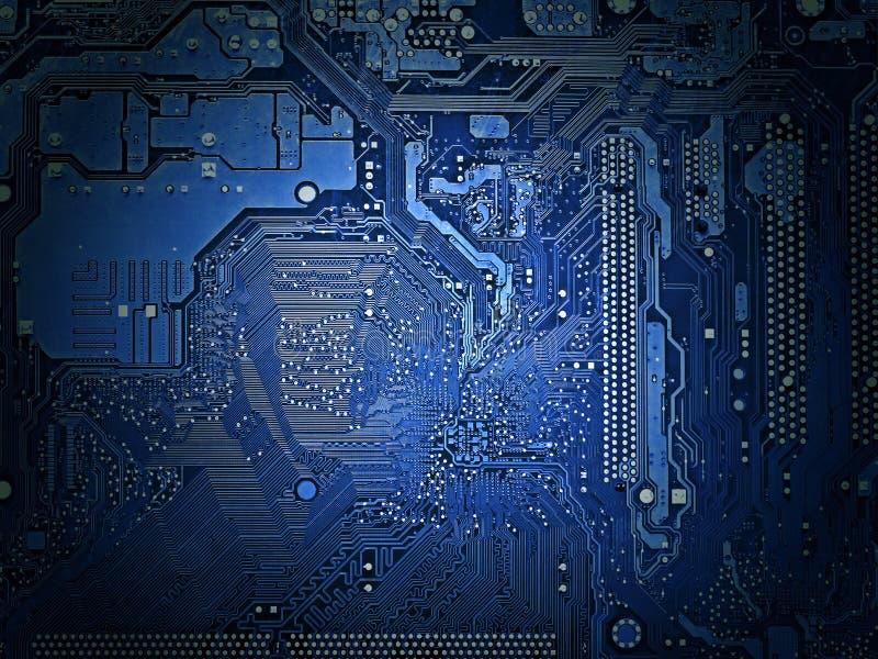 Задняя сторона крупного плана материнской платы, световой эффект, голубой тон стоковая фотография