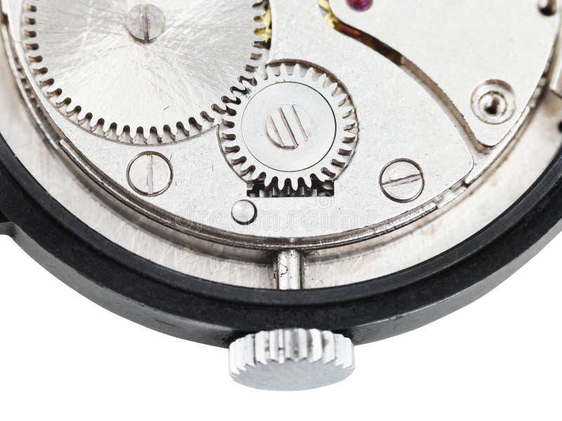 Задняя сторона открытых старых наручных часов изолированных на белизне стоковое изображение