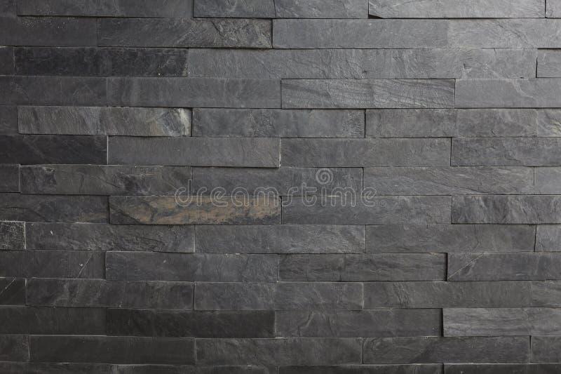 Задняя текстура предпосылки каменной стены с освещать сверху сторону стоковые изображения rf