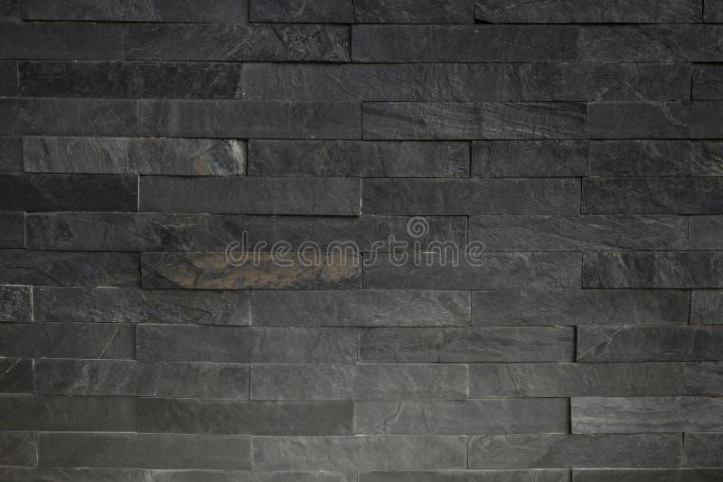 Задняя текстура предпосылки каменной стены с освещением снизу стороны стоковые фотографии rf