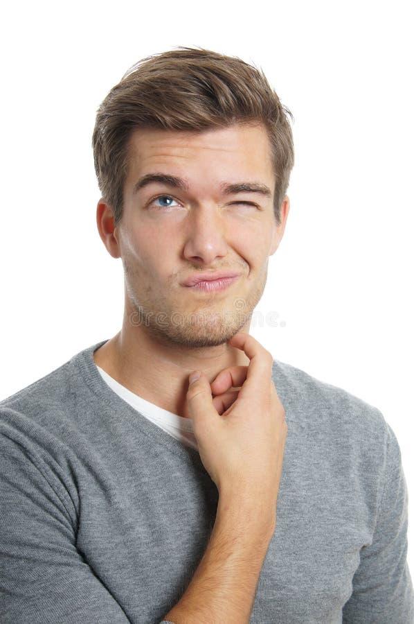 Задумчивый молодой человек стоковая фотография