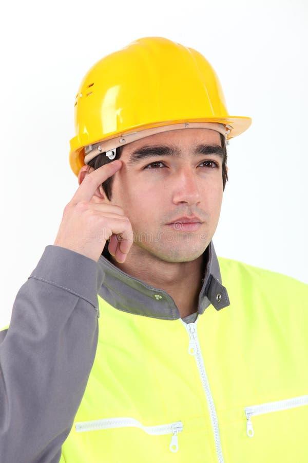 Задумчивый рабочий-строитель. стоковое фото rf