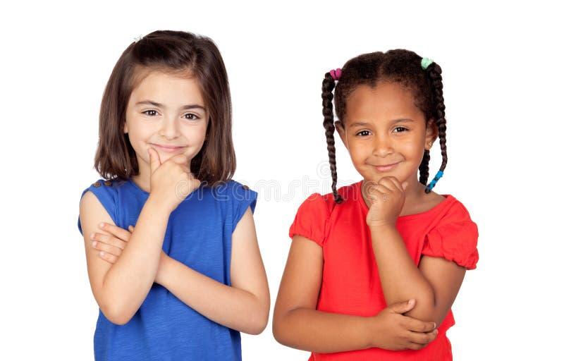 Задумчивый думать маленьких девочек стоковая фотография