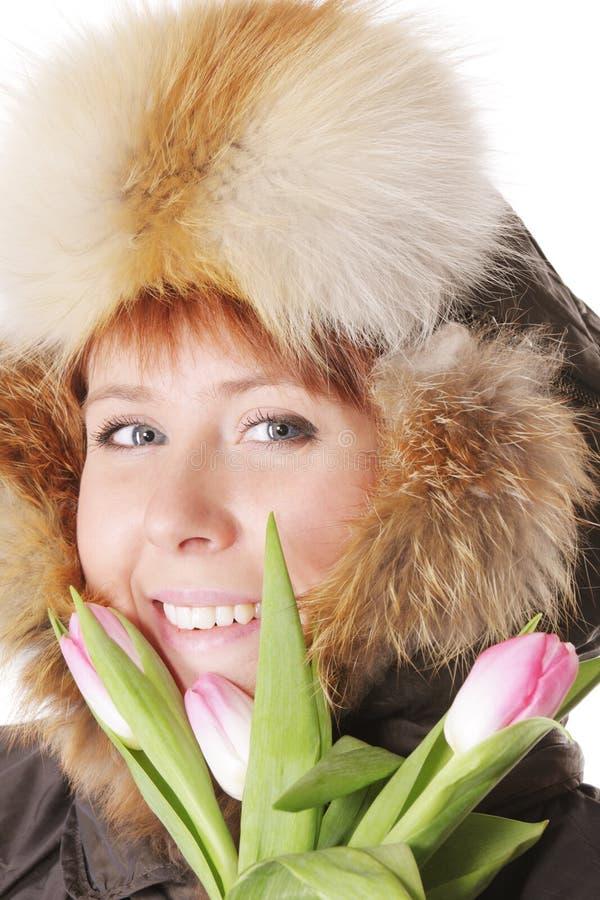 за redhead клобука тюльпаны греют стоковая фотография rf