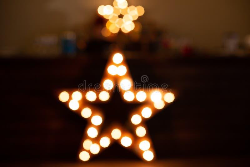 звезда накаляет предпосылка нерезкости электрических лампочек винтажная стоковые фотографии rf