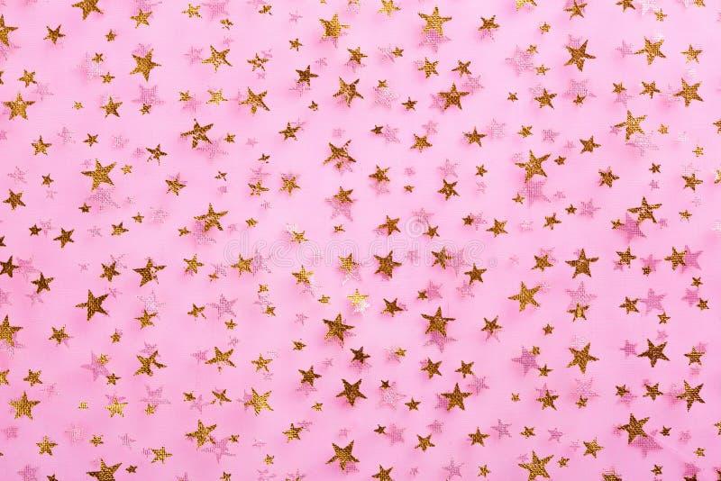 Звезды золота на розовом тканье стоковая фотография rf