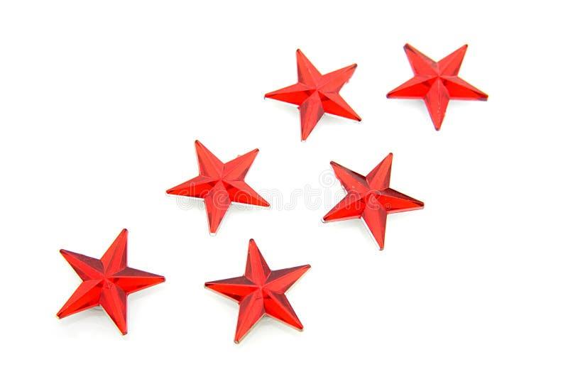 звезды красного цвета confetti иллюстрация вектора