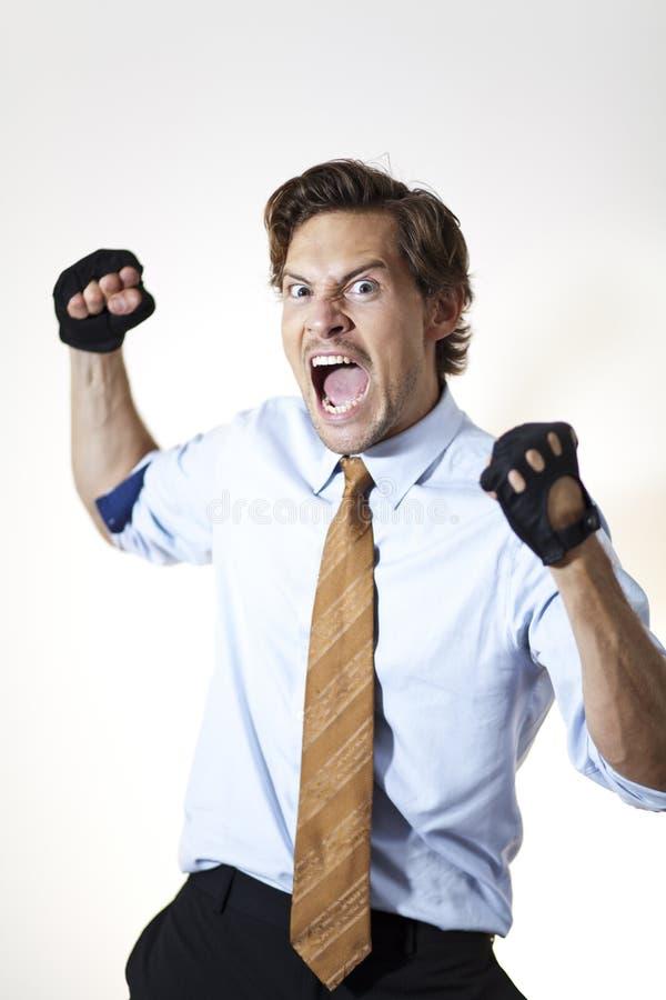 Зверский бизнесмен готовый для того чтобы пробить стоковое фото rf