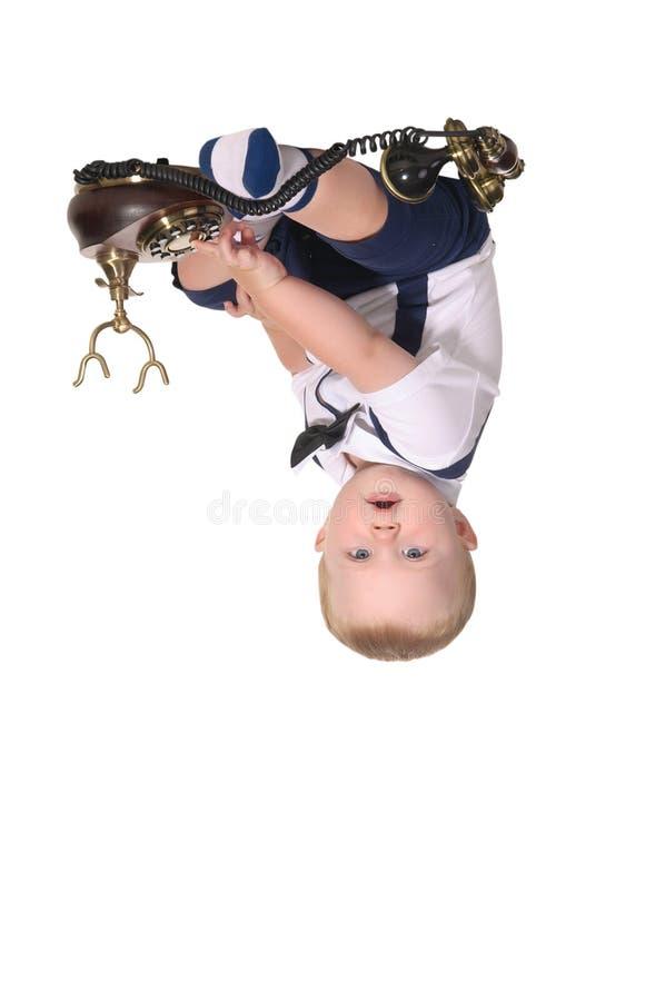 звонить по телефону джентльмена ребёнка стоковые фото