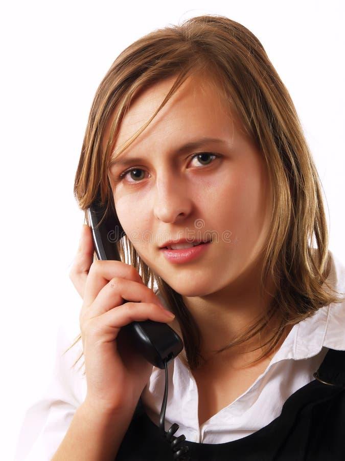 звонок коммерсантки давая детенышей телефона стоковое фото rf
