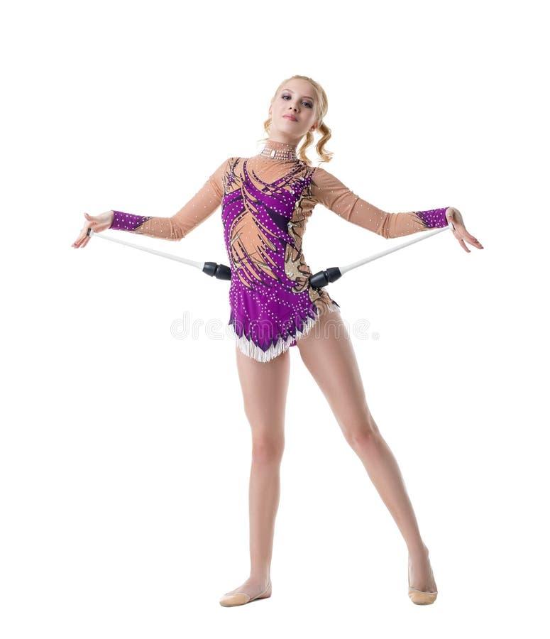 Звукомерный гимнаст представляя в славном костюме с sequins стоковые фотографии rf