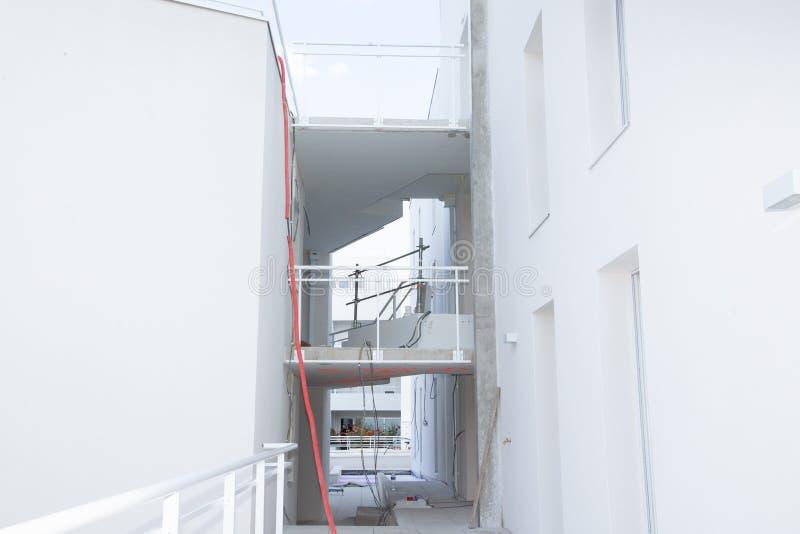 Здание строительной площадки с структурой материала цемента стоковые фотографии rf