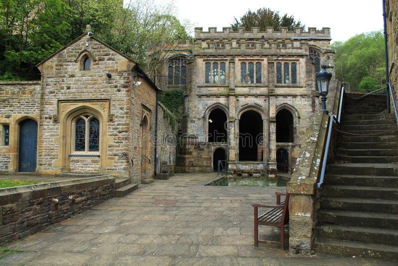 Здания St Winefrides хорошо исторические и купая бассейн, Flintshire, Великобритания стоковые фото