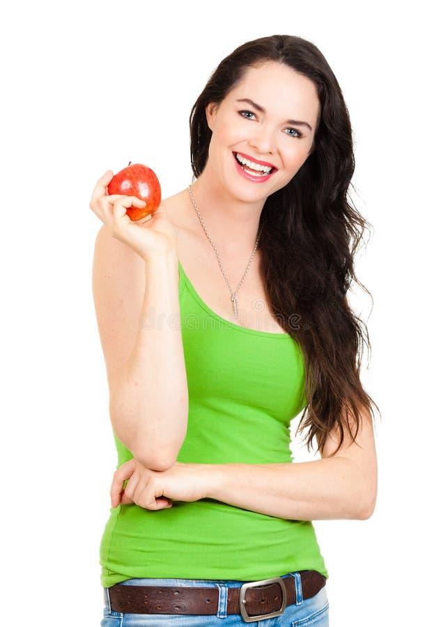Здоровая подходящая ся женщина держа яблоко стоковое фото rf