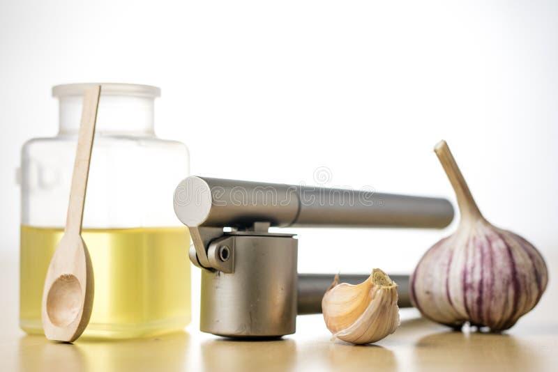 Здоровый и целебный сироп чеснока сжимал с squ кухни стоковая фотография