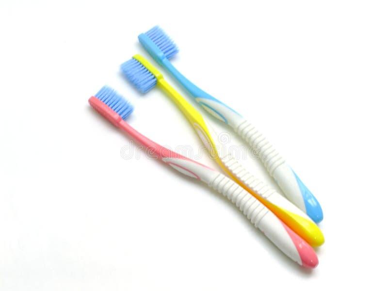 здоровье принципиальной схемы предпосылки зубоврачебное изолировало пестротканые зубные щетки белые стоковое фото rf