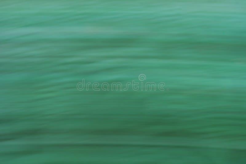 Зеленая абстрактная предпосылка с структурой щетки стоковые фото