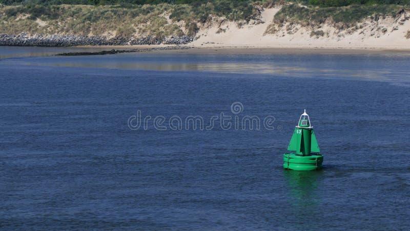 Зеленая береговая линия томбуя стоковая фотография