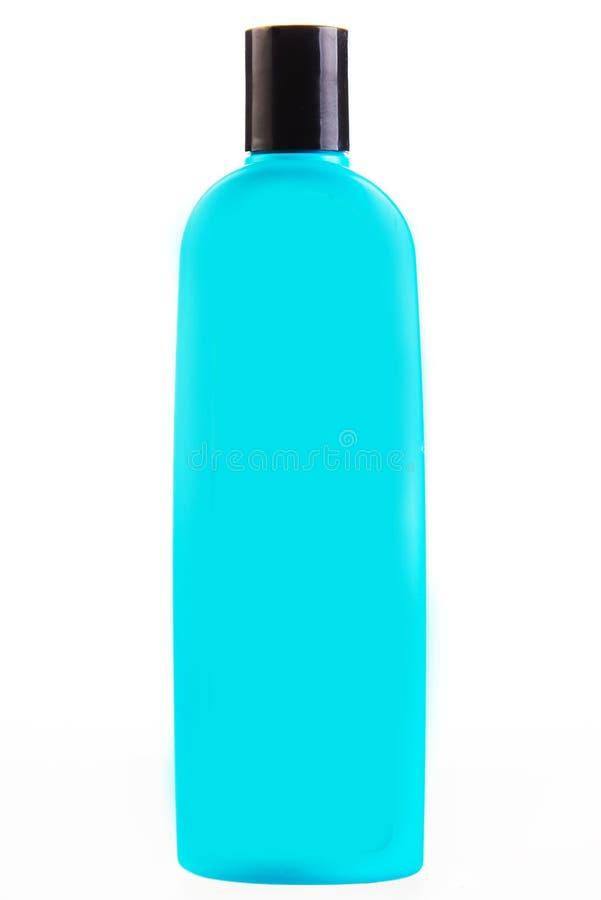 Зеленая бутылка трубки шампуня, проводника, rinse волос, геля, на белой предпосылке с отражением стоковое изображение