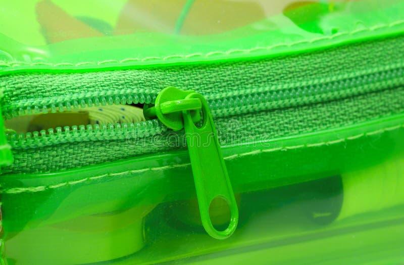 зеленая застежка -молния стоковая фотография