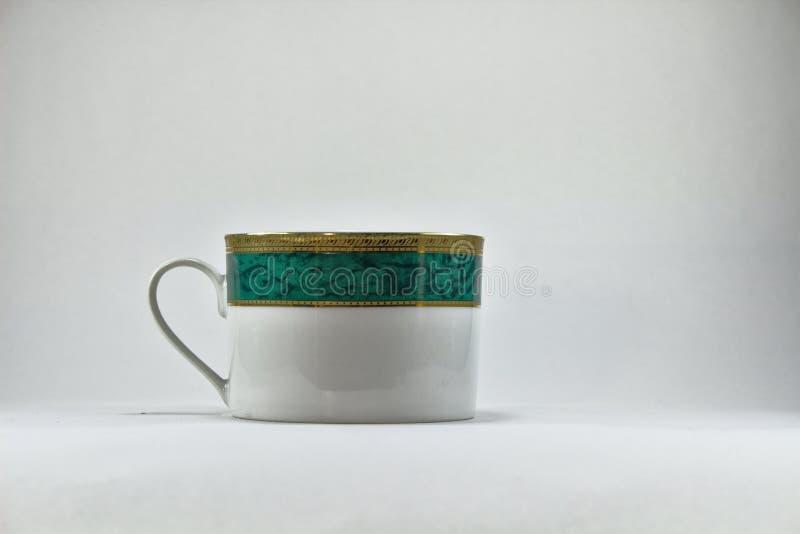 Зеленая и белая чашка чая вышла взгляд 3161 стоковое изображение rf
