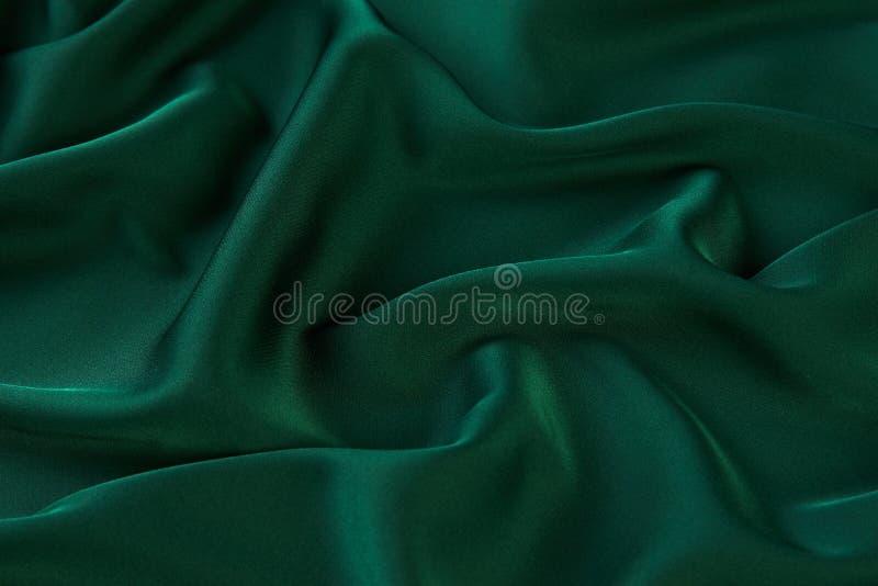 Зеленая предпосылка silk ткани, осматривает сверху стоковое изображение