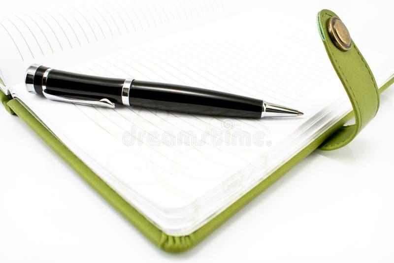 зеленое пер тетради стоковое фото